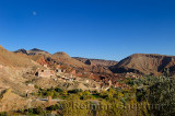 Moon in blue sky over village along Wadi Dades in Dades Gorge Morocco