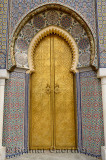 Brass door to the Dar El Makhzen Royal Palace with intricate Zellige tilework in Fes el Jadid Morocco
