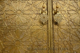 Detail of the intricate engraving on the brass doors to the Dar El Makhzen palace in Fes Morocco