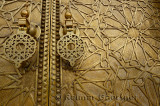 Close up of detailed engraving and knockers on the brass doors to the Dar El Makhzen palace in Fes Morocco