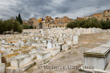 Above ground white tombs in the Mellah Jewish cemetery on a cloudy day in Fes Morocco