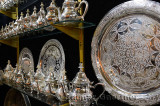 Metalware shop with silver teapots and plates with intricate design engraving Fes Morocco