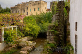 Ancient noria Andelusian waterwheel on Wadi Fes river Morocco