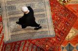 Morrocan Riad owner shopping for a new persian rug in Fes el Bali Medina Morocco