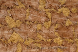 Abstract of processed tanned hides drying on straw in the sun in el Bali Medina Fes Morocco