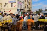 Crowds at fruit stands in the el Bali Medina souk market of Fes Morocco