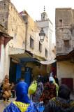 Women in djellabas and head scarfs walking in the el Bali Medina of Fes Morocco