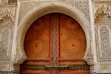 Intricate stone carving and ornate painted door of Kairaouine Mosque in Fes el Bali Medina Morocco