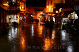 Cafes at Bab Boujeloud Blue Gate on a wet night in Fes el Bali Medina Morocco