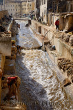 Busy Fes tannery after Eid al Adha with workers washing pelts in the Fes river Morocco