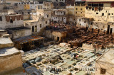 White liming and chrome baths and brown tanning pits in Chouara quarter Fes Tannery Morocco
