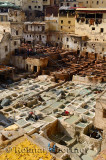 White liming chrome vats and brown tanning pits in Chouara quarter Fes Tannery Morocco