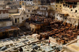 White mineral tanning vats and brown vegetable soaking pits in the Fes tannery Morocco