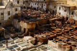 White mineral soaking vats and brown vegetable tanning pits in the Fes tannery Morocco