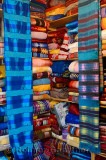 Bright colorful collection of cloth wraps in a Fes Medina Morocco textile shop