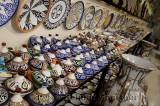 Brightly colored tagine bowls and plates in a ceramic shop in Fes el Bali Medina Morocco