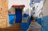 Blue door windows and walls of alley in Oudaia Kasbah Rabat Morocco