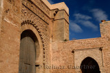 Red ochre stone arch of Bab Oudaia entrance gate to Kasbah in Rabat Morocco