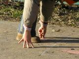 Valeria playing hopscotch in a sunny day