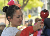 One of the dancers with maraca in hand