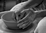 Young hands working ceramic bowl