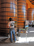 Oil Paintings Being Done in Front of Wine Tanks