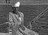Faces of Egypt:  at the helm of his Felucca boat.