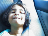 Anchal showing off her dangling tooth!!.jpg