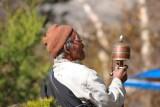 Old man turns prayer's mill