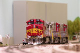 BNSF 852 a re numbered/weathered Atlas Dash 8-40CW.
