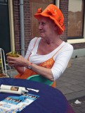 Orange lady enjoying her drink