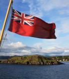 Civil Ensign of the United Kingdom over Oban Scotland.jpg