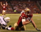 San Francisco 49ers tightend Billy Bajema scores a TD with QB Alex Smith celebrating in the background