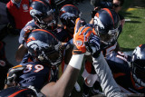 Denver Broncos team huddle