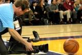 TV cameraman shooting the basketball