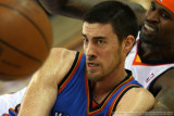 Oklahoma City Thunder's Nick Collison pitches the loose ball away from Golden State Warriors' Stephen Jackson