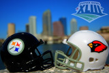 Pocket replica helmets of the Super Bowl XLIII teams with downtown Tampa in the background