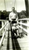 Dad pushing Mike across bridge in 1952