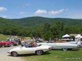 Jaguar XKE and 1959 Cadillac Convertible