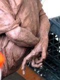 boy, bound hands :: clay