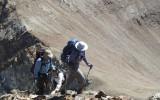 Pushing through the steep terrain.