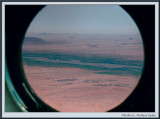 Nile River framed by Helicopter porthole (1267)