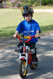 Carter and Brooks riding without training wheels