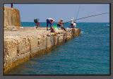Fishermen at the ancient Caesarea's harbour
