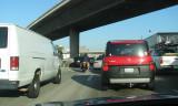 Two-wheeler negotiates LA highway traffic