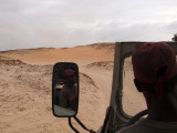 The kid driving our vehicle over the dunes