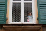 Window with a doll