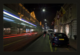 Geneva at night... outgoing tram and cyclist ....