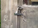 lock gray bullet holes.JPG