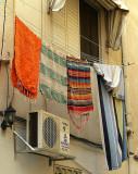 striped rugs hanging.JPG